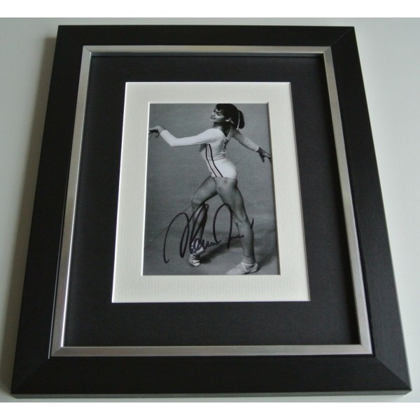 Nadia Comaneci SIGNED 10x8 FRAMED Photo Autograph Display Olympic Gymnastics COA AFTAL Memorabilia PERFECT GIFT