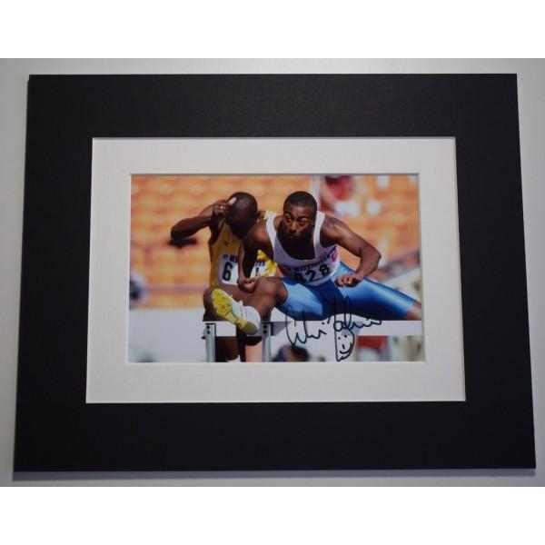 Colin Jackson Signed Autograph 10x8 photo display Olympics Hurdles AFTAL &  COA Memorabilia PERFECT GIFT